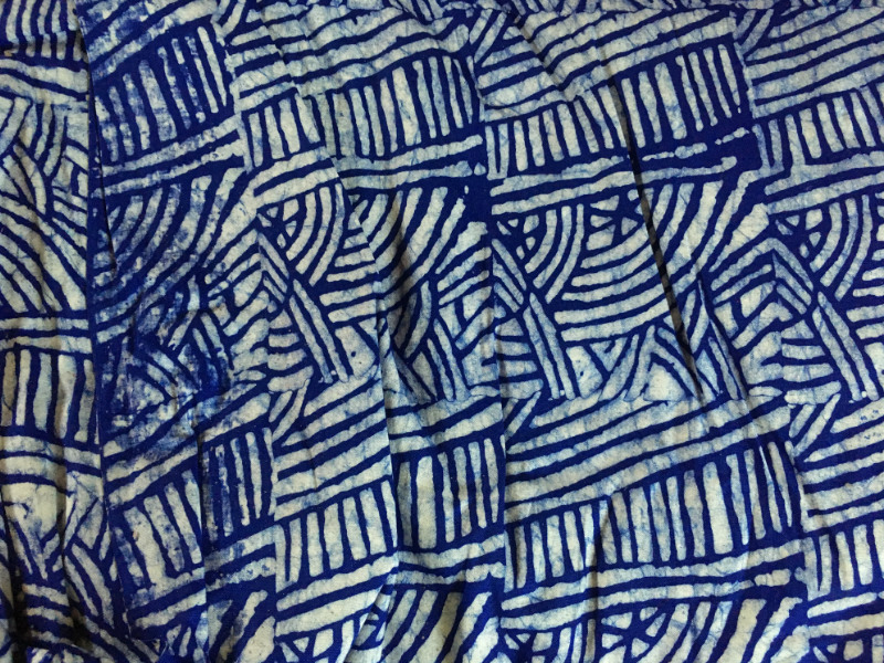A blue traditional Batik fabric design produced in Ghana West Africa by hand