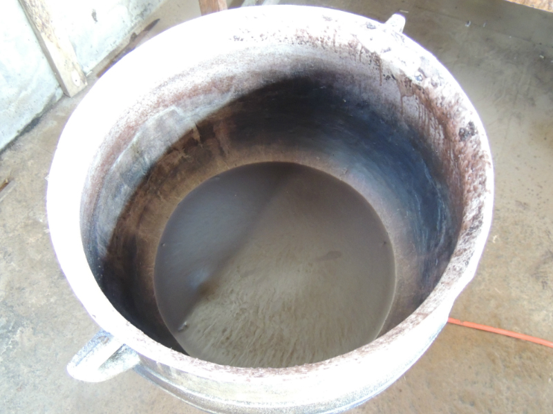 Basin of unmelted wax used in the traditional batik making process in Ghana West Africa