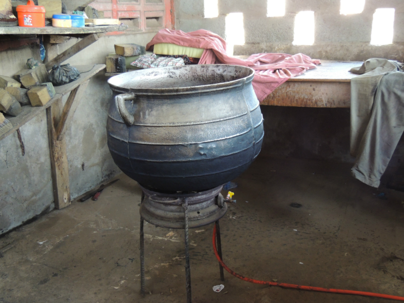 A basin where the wax is melted inside for making traditional batik fabric by hand in a Ghanaian workshop