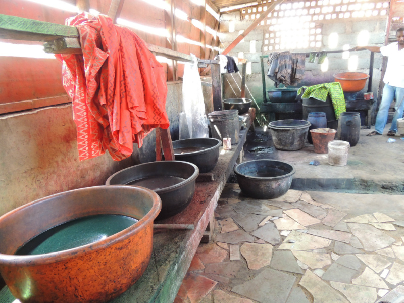 Different colour dye baths inside a traditional batik making workshop in Ghana West Africa