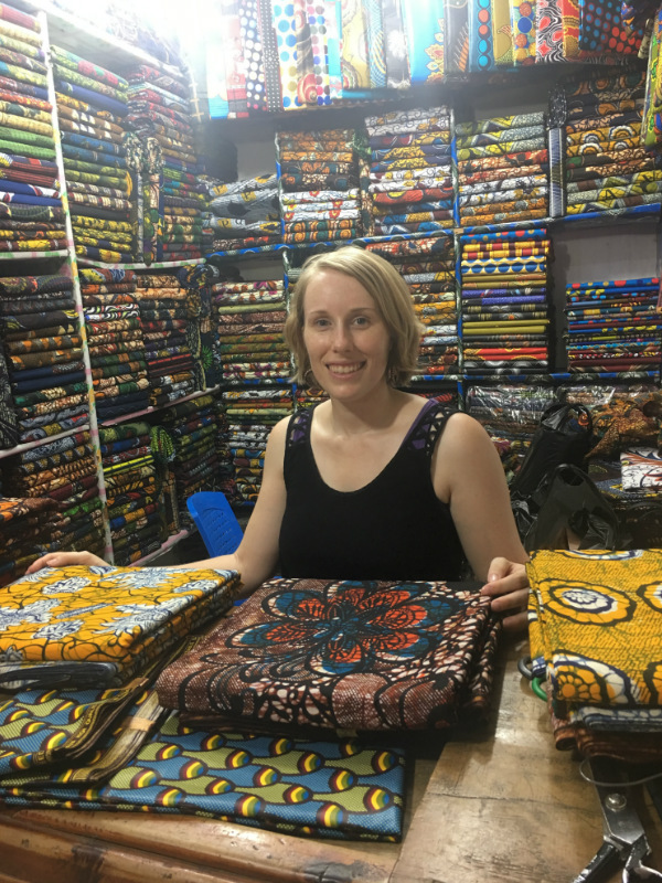 Kitneg Store founder Sian shopping for the best fabrics to make modern african print clothing at the market in Tanzania East Africa