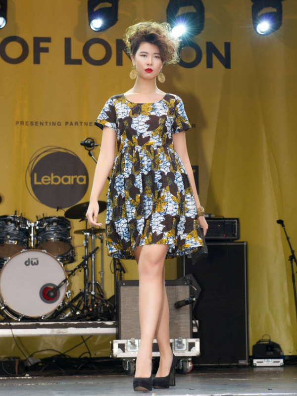 African Fashion Week London model wearing a Kitenge African print fit and flare dress on the runway at Africa on The Square 2015 in Trafalgar Square organised by The Mayor of London