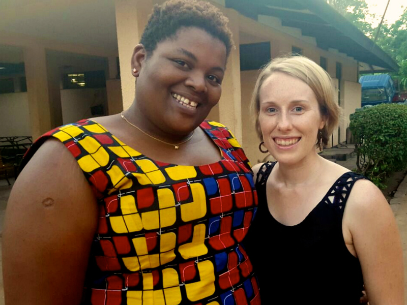 Kitenge founder Sian with our African print accessories tailor Betty in Tanzania standing outside her family home