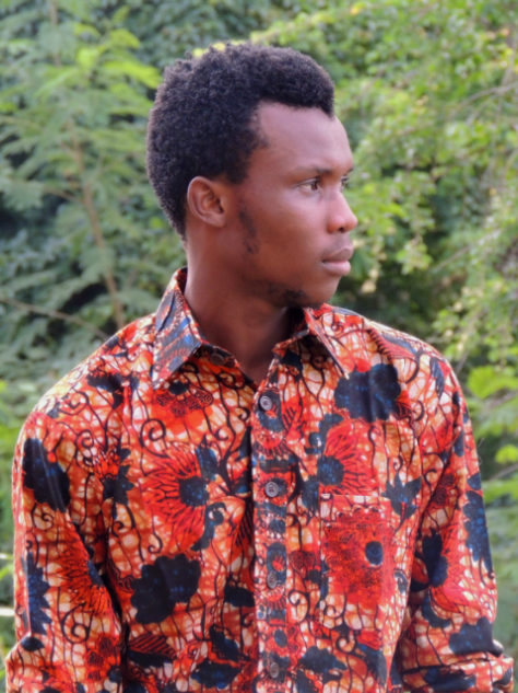 Men's red floral African print long sleeve shirt model wearing Tanzania close up