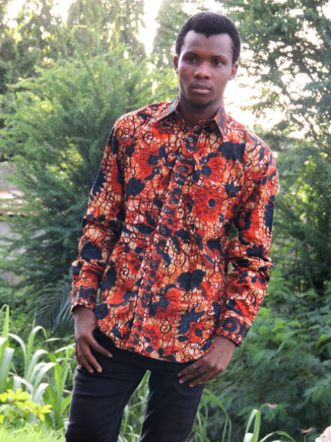 Men's red floral African print long sleeve shirt model wearing Tanzania outside