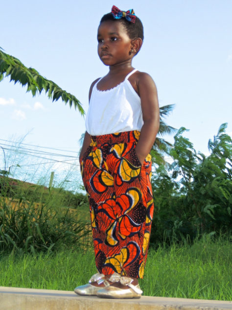 Red African print kids trousers pants model wearing in Tanzania