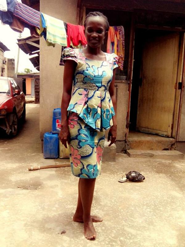 A tailored African print peplum dress worn by Tanzanian women in East Africa