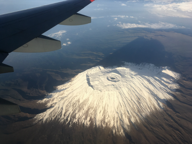 aerial view of Mount Kilimanjaro's snow capped peak in Tanzania