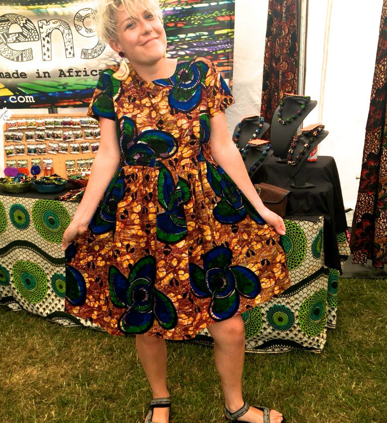 Kitenge customer proudly wearing her new yellow African print dress at Africa Oye Festival in Liverpool, UK