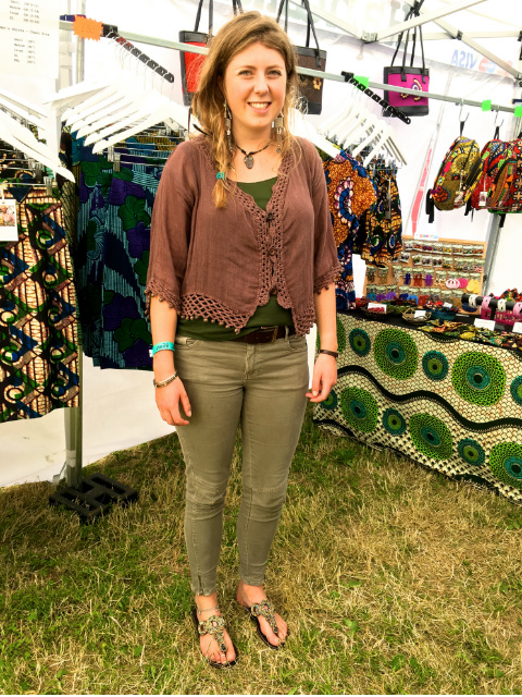 A Kitenge customer modelling her handmade African beaded leather sandals at LarmerTree Festival UK