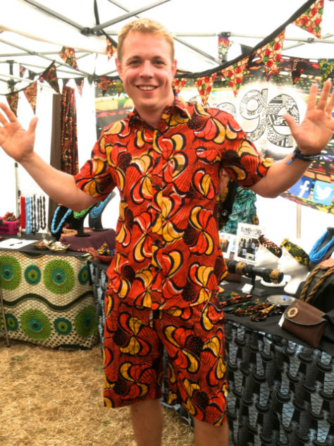 Men's red yellow African print short sleeved shirt and matching shorts kitenge customer wearing at womad festival uk