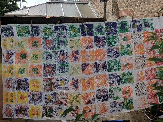 Children's kitenge inspired printing art installation drying outside after class