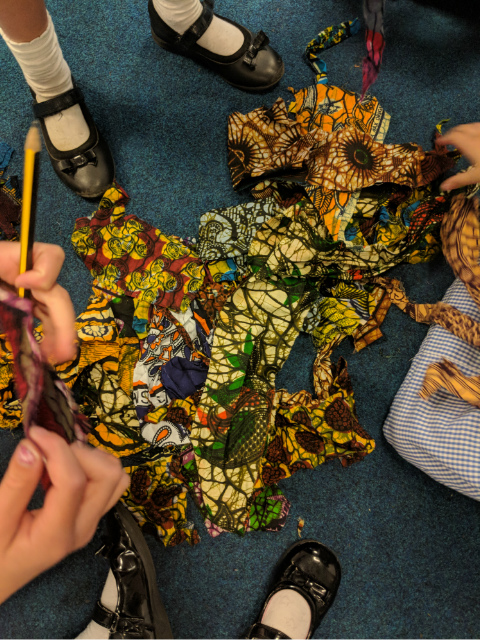 Primary school children inspired by African wax print fabrics art printing class