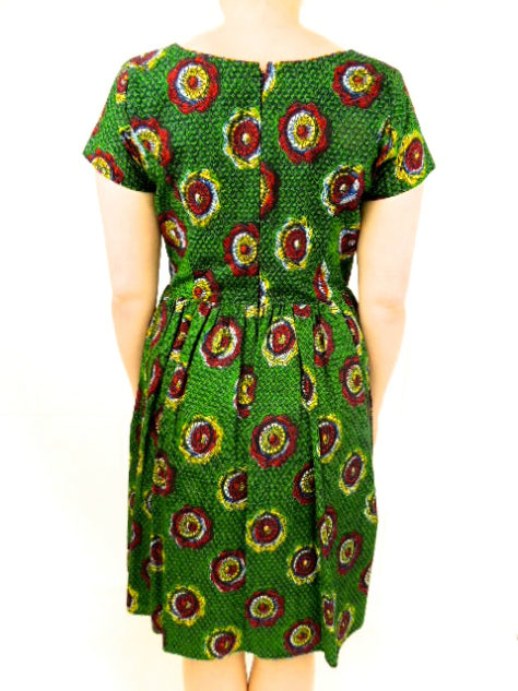 Green African print fit and flare dress model wearing back view